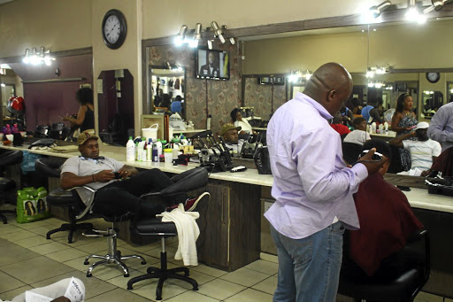 A doctor who works at a hair salon has been battling to find a job and has been working at the salon run by his wife in Pretoria.