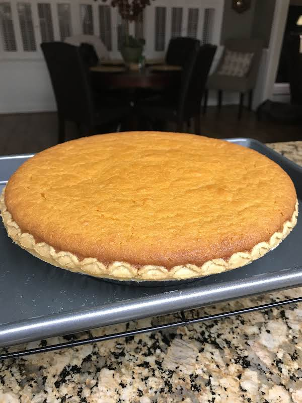 A Baked Pie On A Cooling Rack.