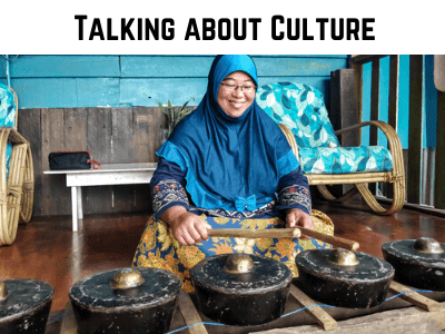 a woman playing music in malaysia used as a cover photo for cultural writing section on the blog on my canvas