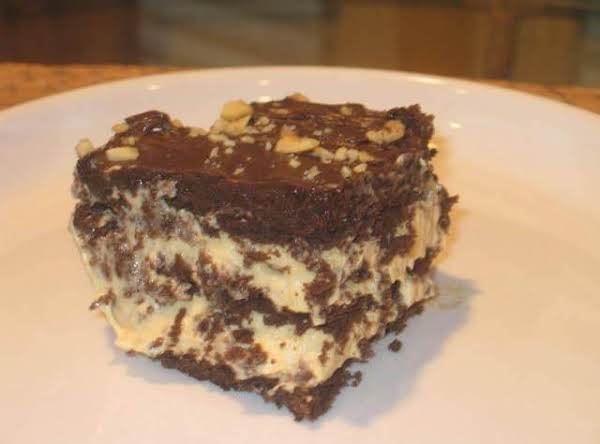 Frosted Peanut Butter Chocolate Eclair Cake