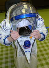 Photo: Then comes the tricky part, passing the head through the neck ring. I have been a bit spoiled during my training sessions, because the Sokol suits I got were typically a bit big for my size and that makes this maneuver a lot easier. When I put on my custom-made suit last week, I had to work a lot harder. You need to make sure that the back side of the suit is as stretched as possible and then you need to tuck in your head while you push the neck ring forward. Tricky at first, but after some practice it's not so hard.