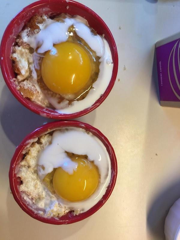 Crack 1 egg in each ramekin and add 1 1/2 tablespoon of heavy cream...