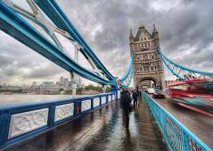 Photo: Crossing Tower Bridge in the Rain  My bulbous 14-24 lens is a problem in the rain! If you haven't seen the Nikon 14-24 (see my Nikon 14-24 Review) before, then most people think it is a fish-eye lens, but it isn't. The apex of the glass juts out almost just beyond the tiny bayonet, and it seems to suck rain drops into it! I'm always wiping down that dang thing.  from the blog www.stuckincustoms.com