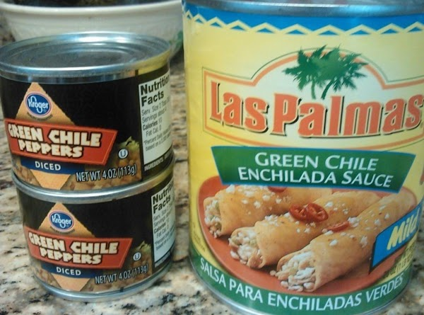 Place green enchilada sauce in bottom of slow cooker.