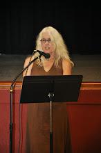 Photo: Denise Calvetti Michaels reads her poetry.