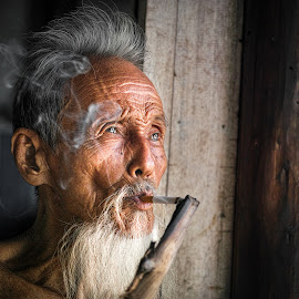 A cloud of smoke slides along old face by Sơn Hải - People Portraits of Men ( vintage, vietnamese, old man, vietnam, people, portrait,  )