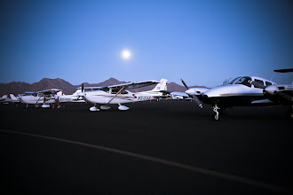 Photo: The Scottsdale Muncipal Airport runway framed by the McDowell Mountains and the rising full moon.