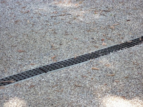 Photo: This plastic grating and channel can be used to guide water to a rain garden.