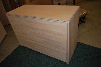 Photo: This is a side view of our unfinished 3 drawer dresser to allow our customers to finish to their unique decor