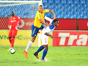 Mamelodi Sundowns' Wayne Arendse, who scored the opening goal, is challenged by Mbondi Christ of Rayon Sports  during last night's CAF Champions League eliminator at Loftus Versfeld. Downs won 2-0 to qualify for the group stages.