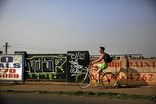 Killian Crouvezier, 20, stays cool on his bike tour of Soweto.