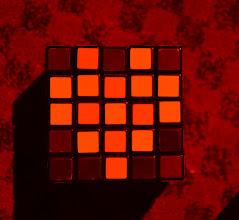 Photo: Rubic cube under reddish lighting