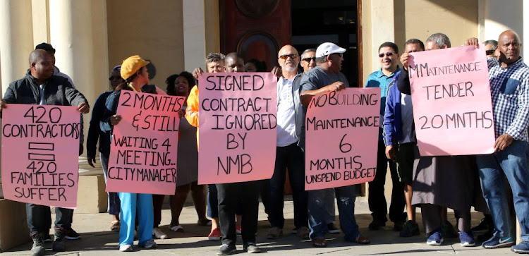 Small municipal maintenance protest at city hall yesterday