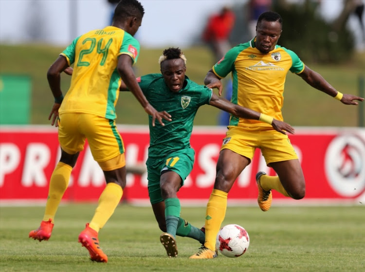Kudakwashe Mahachi of Golden Arrows and Hassan Banda of Baroka FC during the Absa Premiership match between Golden Arrows and Baroka at Princess Magogo Stadium on January 28, 2018 in Durban.