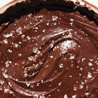 CHOCOLATE-TAHINI TART WITH CRUNCHY SALT.