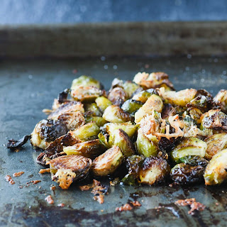 Crispy Roasted Brussels Sprouts With Parmesan & Pomegranate Syrup.