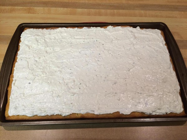 Blend together cream cheese, mayo, sour cream, and ranch seasoning. Spread over cooled crust.
