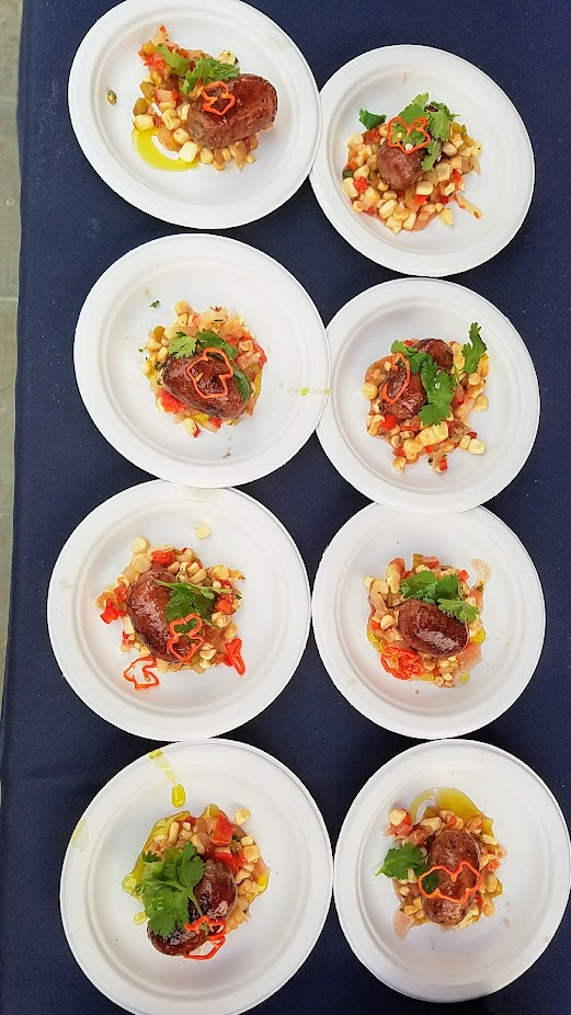 Review of Feast PDX Smoked 2017, Rich Meyer of Trifecta Tavern and Bakery passed out Grilled Goat and Pork Kielbasa with Smoked Corn Salsa