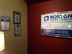 Photo: Boston Appliance Company in Boston, MA proudly displaying their BBB Accreditation certificates and awards