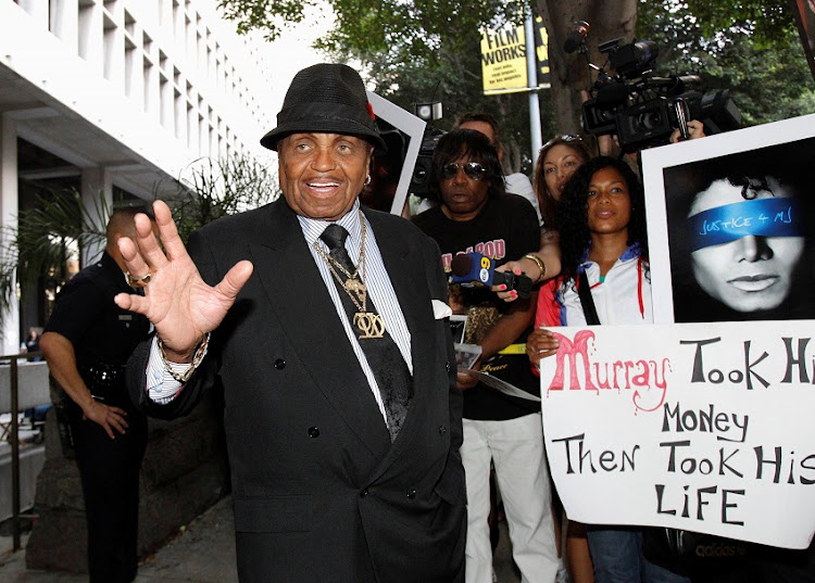 Joe Jackson, father of the late pop star Michael Jackson, leaves the courthouse during Dr. Conrad Murray's trial in the death of his son in Los Angeles, California, U.S., September 28, 2011.