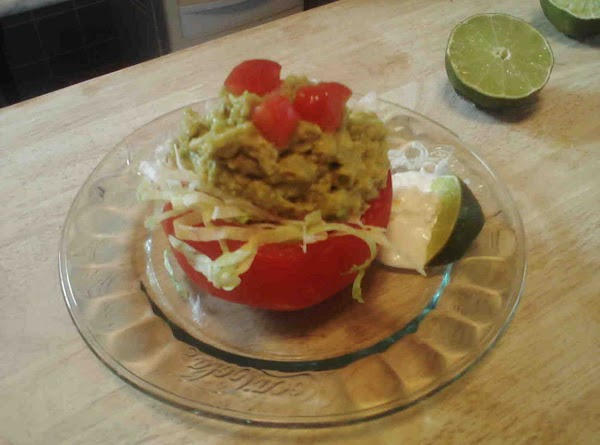 Layer each tomato cup with shredded lettuce, then guacamole, sprinkle few chopped tomatoes. Serve...