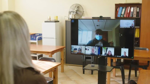 South Africa: A teacher at Charter College International School hosts a virtual class using Avaya Spaces and the Avaya Collaboration Unit.