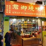 eating braised pigeon in Hong Kong at Kwan Yu Roasted Meat in Hong Kong, , Hong Kong SAR