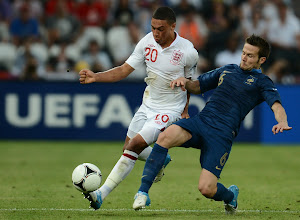 Photo: Yohan Cabaye of France tackles Alex Oxlade-Chamberlain of England during the UEFA EURO 2012 group D match between France and England at Donbass Arena on June 11, 2012 in Donetsk, Ukraine.