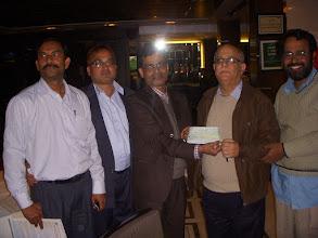Photo: Mr. Das  circle secretary BSNLCO presenting a cheque Rs. 51000/- to GS