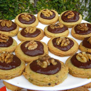 Pistachio Butter Cookies Topped with Chocolate and Walnuts