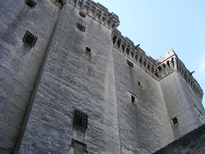 Photo: And a banner that size befits a castle with these dimensions, with the walls rising to 160 feet. Here, a view up the side, revealing the machiolated towers and the crenellated wall summits.