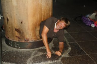 Photo: Me crawling through a small hole in the foundation of the temple
