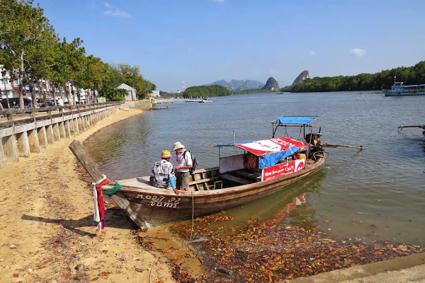 Depart from Krabi Town by traditional longtail boat