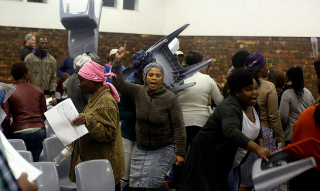 Community members take out their frustration on chairs during the rowdy Integrated Development Plan meeting in Seaview last night