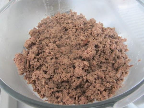 Brown ground beef, drain