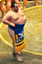 Photo: One of the bigger Rikishi, a foreigner, wearing the ceremonial Mawashi.