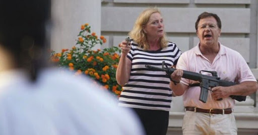 Governor pardons St. Louis couple who brandished guns when BLM stormed neighborhood