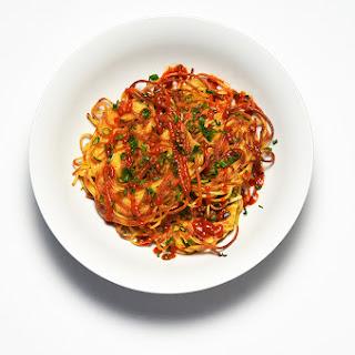 Spaghetti Scallion Pancakes with Hot Sauce.