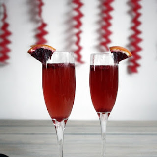 Blood Orange-Pomegrante Champagne Cocktail.