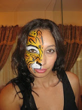 Photo: Maria paints her own face to practice. Call to book her today: 888-750-7024 http://www.memorableevententertainment.com/FacePainting/MariaChino,Ca.aspx