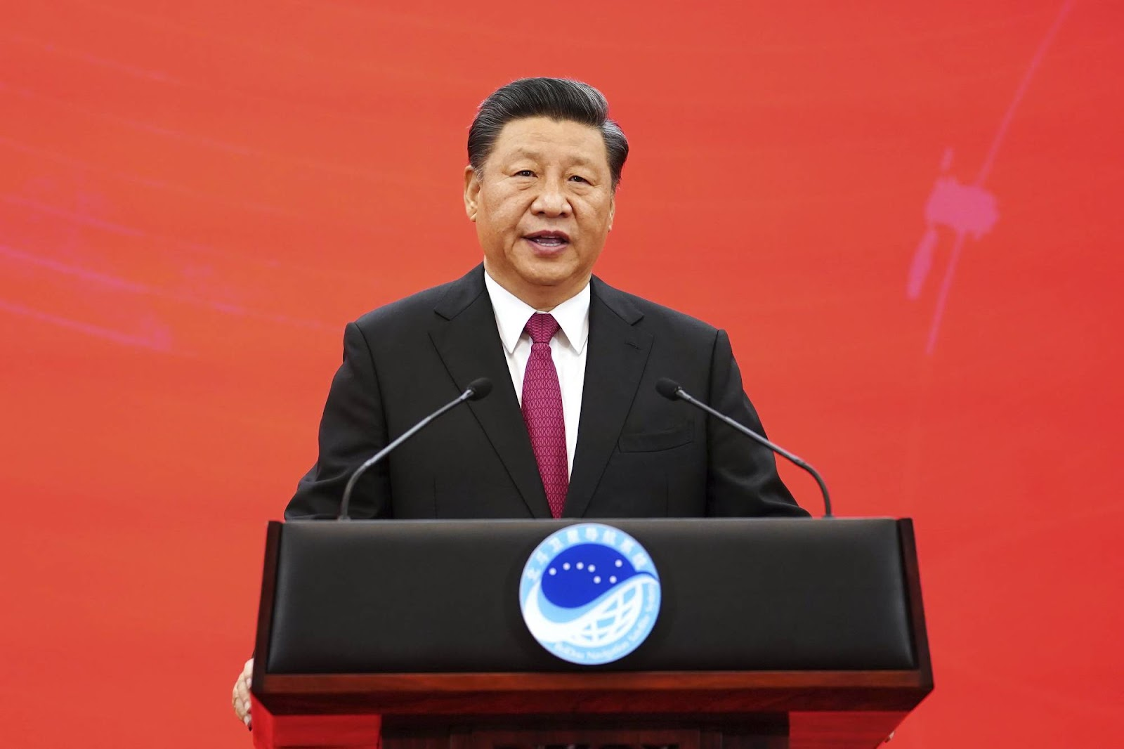Chinese President Xi Jinping speaks during a ceremony on July 31. | Xinhua / via AP