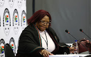 Former ANC MP, Vytjie Mentor looks at her papers during a break at the state capture commission in Parktown, Johannesburg.