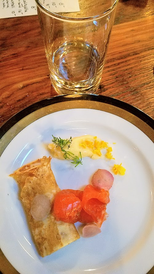 Fimbul PDX, an Icelandic Pop up, snack course of Dung-smoked trout, radish, hay butter