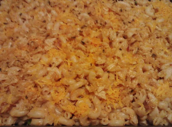 Pour pasta in cheese sauce and mix well.Pour into baking dish. Top with 1/2...