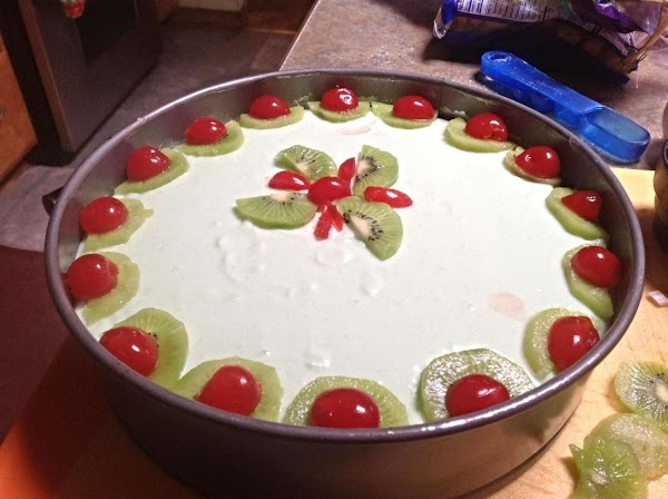 Pour into prepared  spring form pan. Garnish top with fresh kiwi slices if...