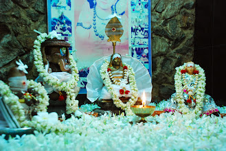 Photo: our Cave shrine floating with white flowers