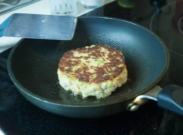 Heat the oil in a sauté pan, and cook the fish cakes about two...