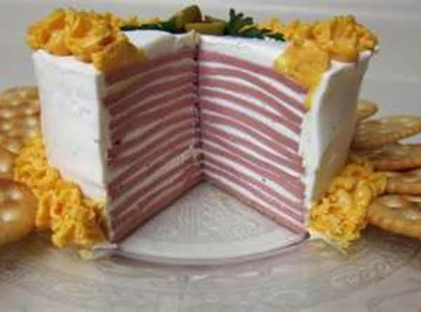 This Photo Is Also Not Mine. Appears That Someone Used Canned Cheese To Pipe Icing On Their Bologna Cake. When I Finish My First Bologna Cake I Will Upload A Pic Of My Own.