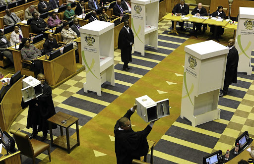 Officials show MPs that the ballot boxes are empty ahead of Tuesday's no-confidence vote in parliament, which was done the old-fashioned way.  Picture:  Ruvan Boshoff