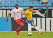 Ali Meza (R) of Mamelodi Sundowns is tackled by man-of-the-match Junior Sibande of Highlands Park during the Absa Premiership match at Loftus Versfeld Stadium in Pretoria on August 22 2018.